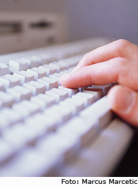 Photo: fingers on keyboard